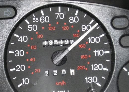 a close up of a speedometer showing that the driver is speeding above 90 mph