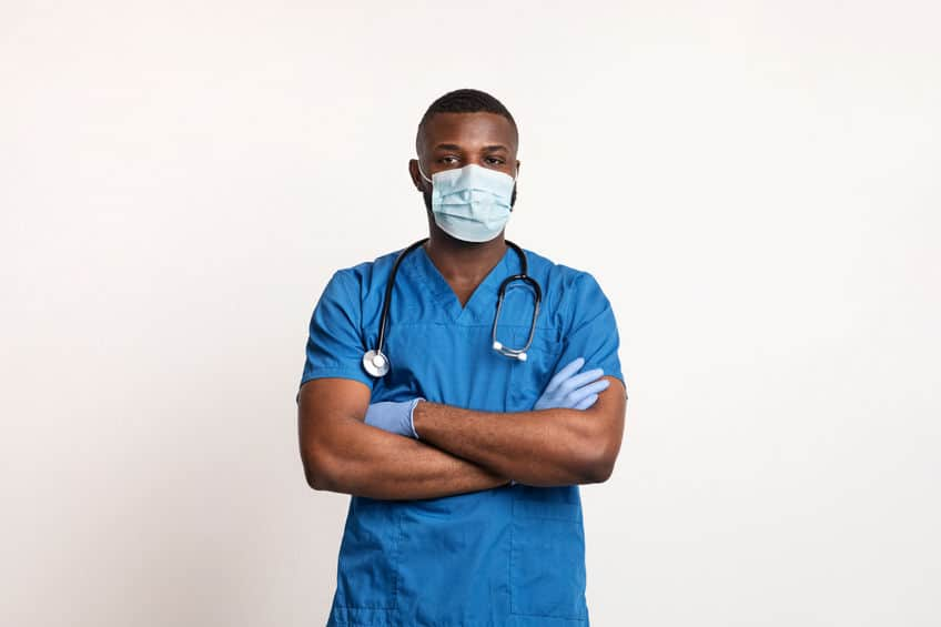Confident black doctor in face mask and gloves