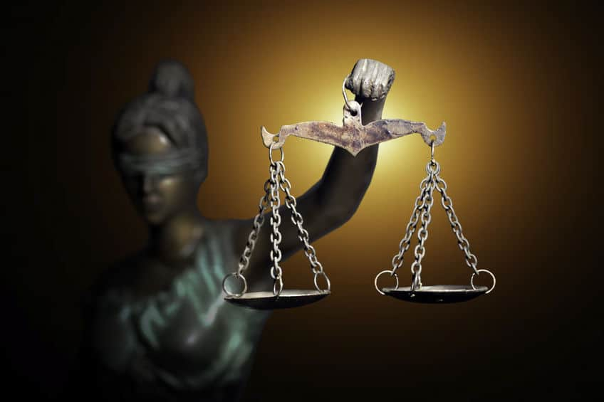 Lady Justice figure with scales highlighted