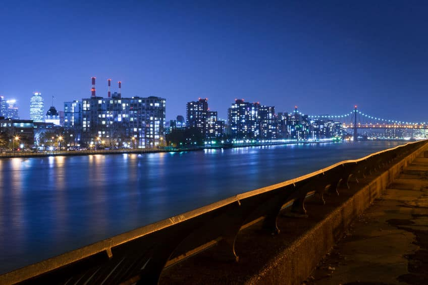 Queensboro Bridge and Queens skyline by the East River, at night, New York City, USA