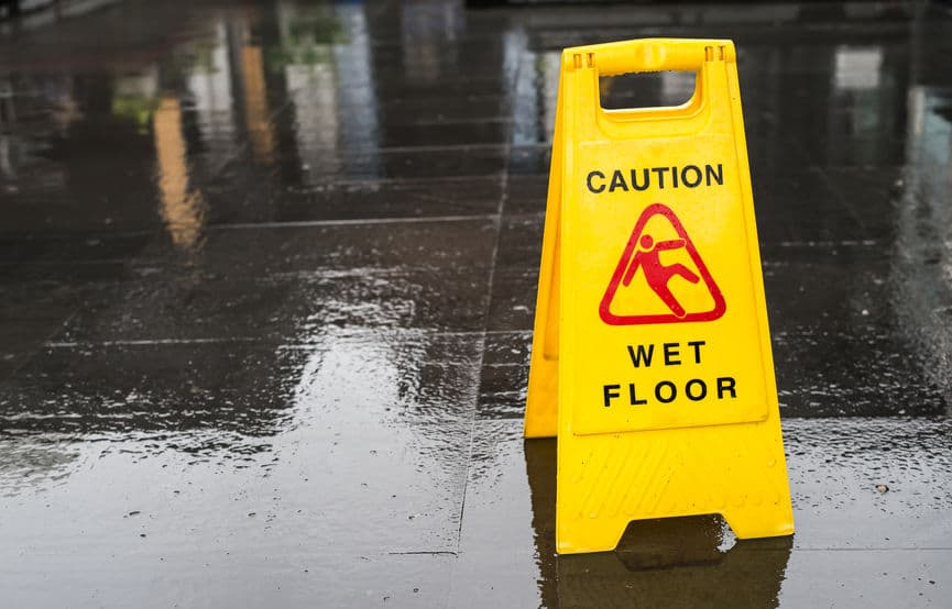 caution wet floor sign on a slippery floor