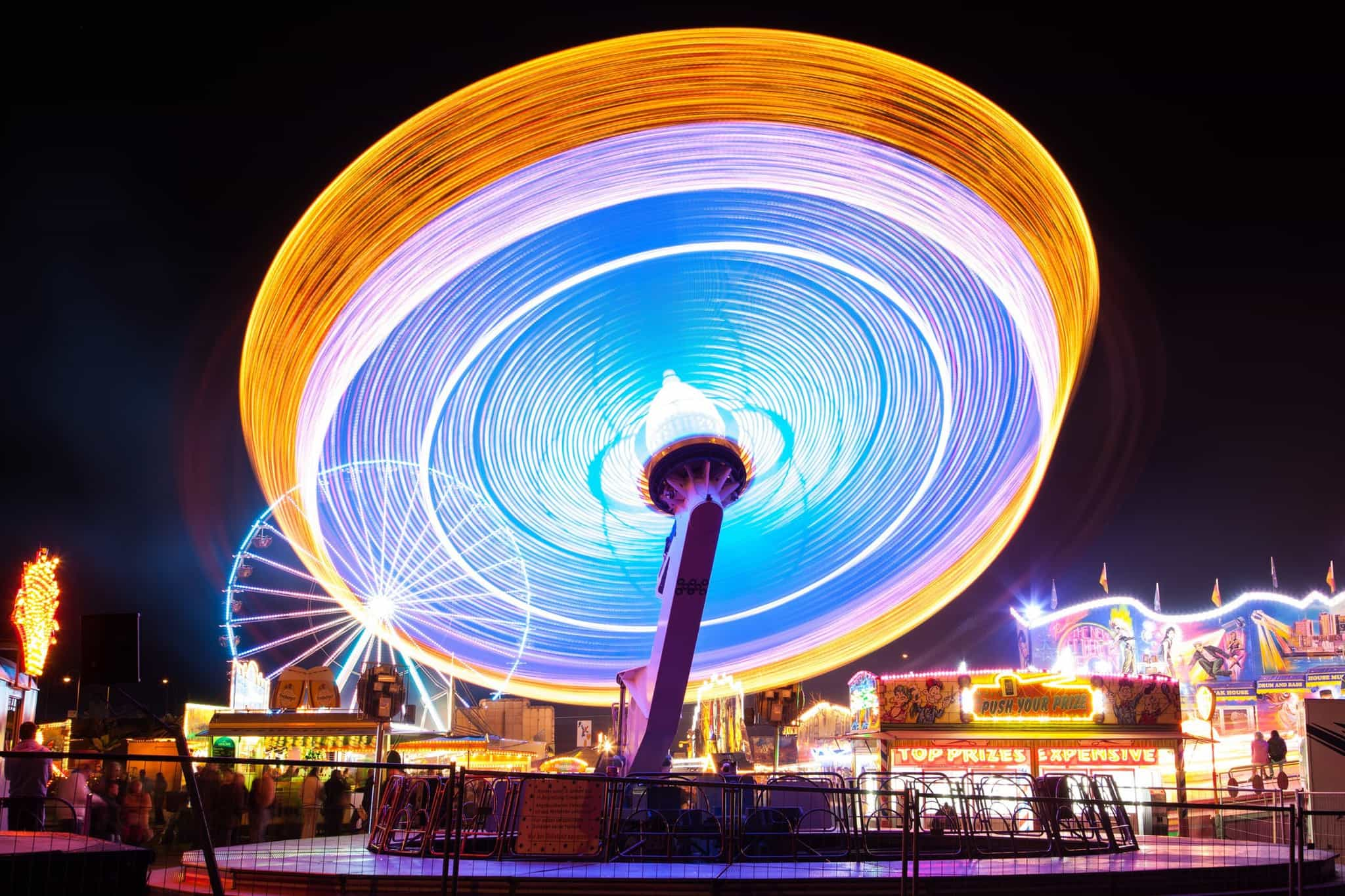 spinning carnival ride lit up at night