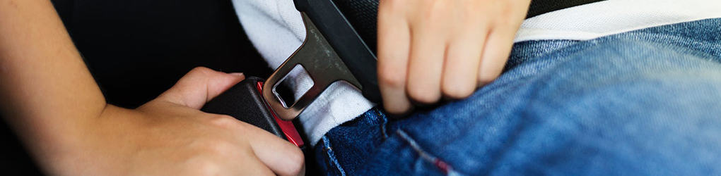 close up of a person buckling their seat belt