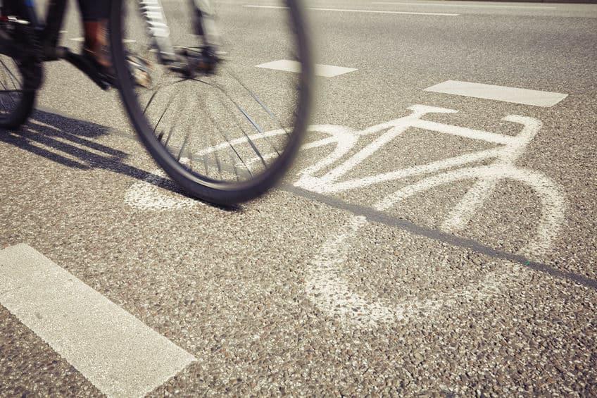 close up of a tire of a bike in the bike lane