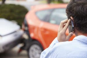driver on the phone with the barnes firm after being hit in a car accident