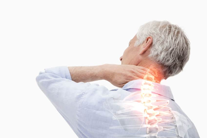 man holding the back of his neck with his spine highlighted