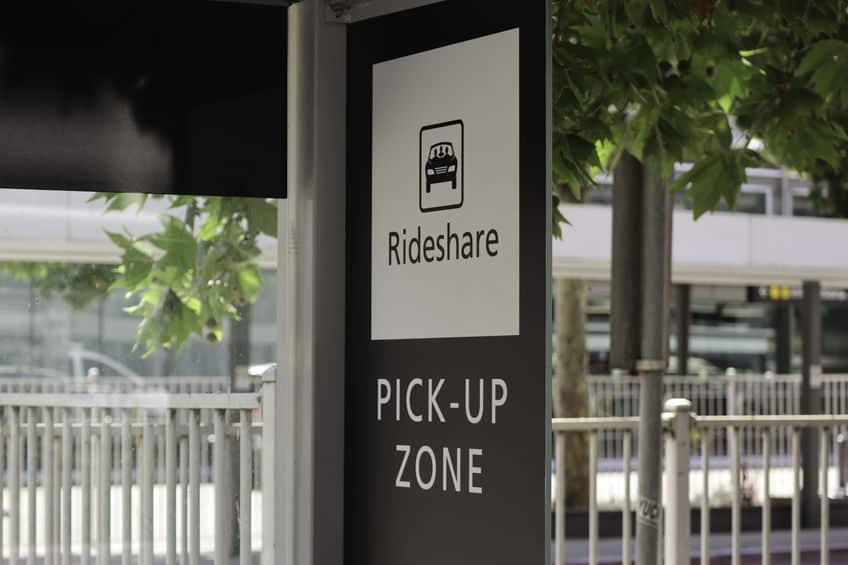 Black and white rideshare pick-up zone sign