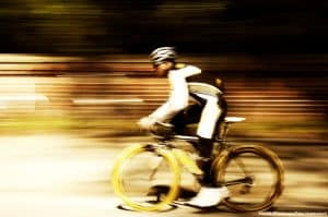 cyclist riding a bike with a blurred background