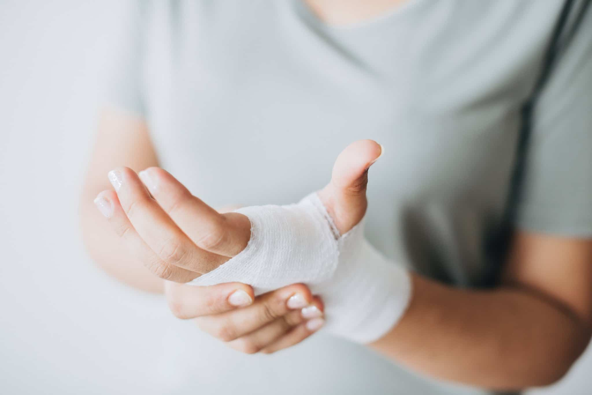 person holding their bandaged hand