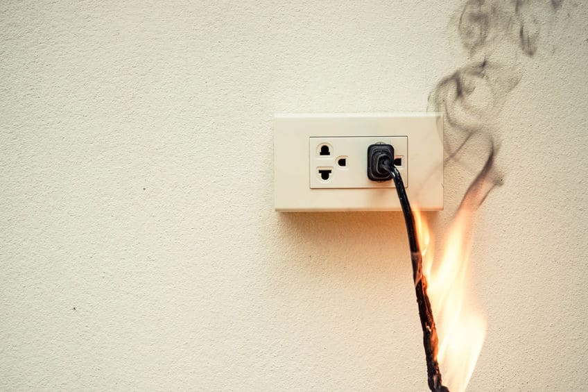 on fire cord plugged into outlet