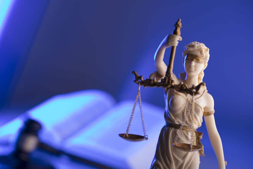 lady justice with gavel and open law book