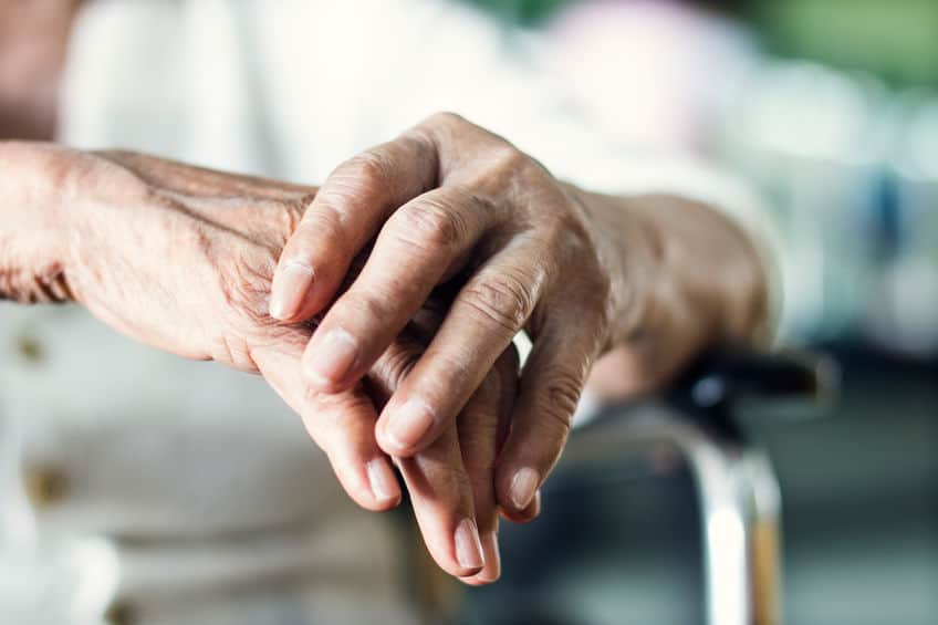 Close up hands of senior elderly woman
