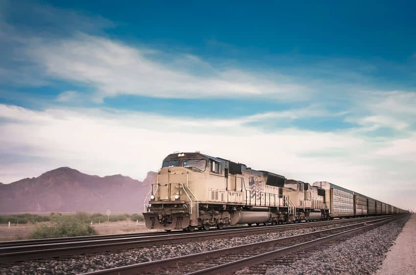 freight train travelling arizona desert