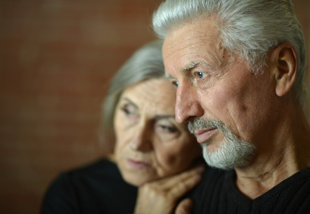 sad elderly couple