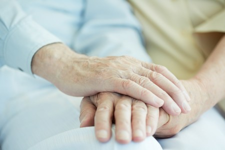 close up of seniors hands holding each other