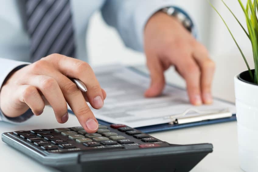 close up of an accountant or banker calculating insurance