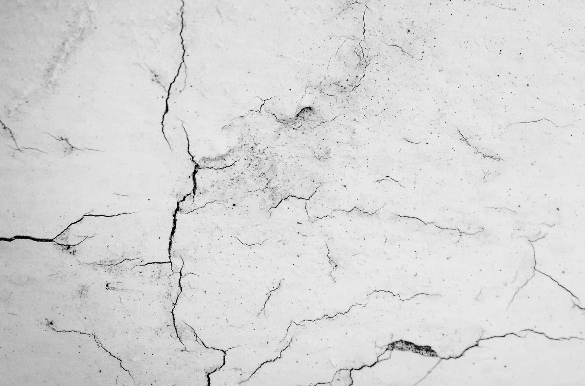 Grunge concrete cement wall with crack in industrial building