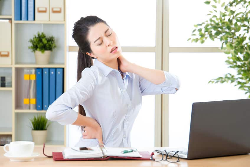 business woman with back pain and neck pain in office