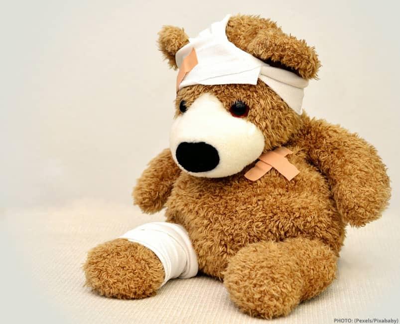 injured and bandaged teddy bear