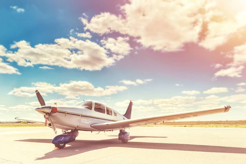 single engine airplane parked at the airport