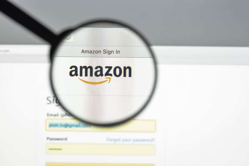 a magnifying glass over the amazon.com sign in page, magnifying the amazon logo