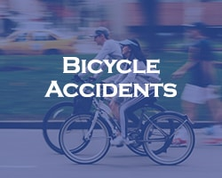 Bicycle Accidents - blue overlay on two people riding bikes on the street with a car in the background