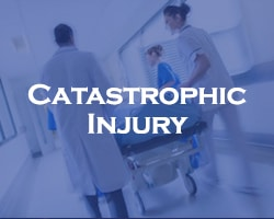 Catastrophic Injury - blue over doctors and nurses pushing someone on a gurney in a hospital bed