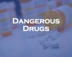 Dangerous Drugs - blue overlay on pill bottle tipped over with pills scattered across a table