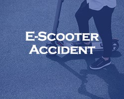 E-Scooter Accident - blue over a person on an e-scooter