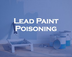 Lead Paint Poisoning - blue over a partially painted wall with painting supplies below