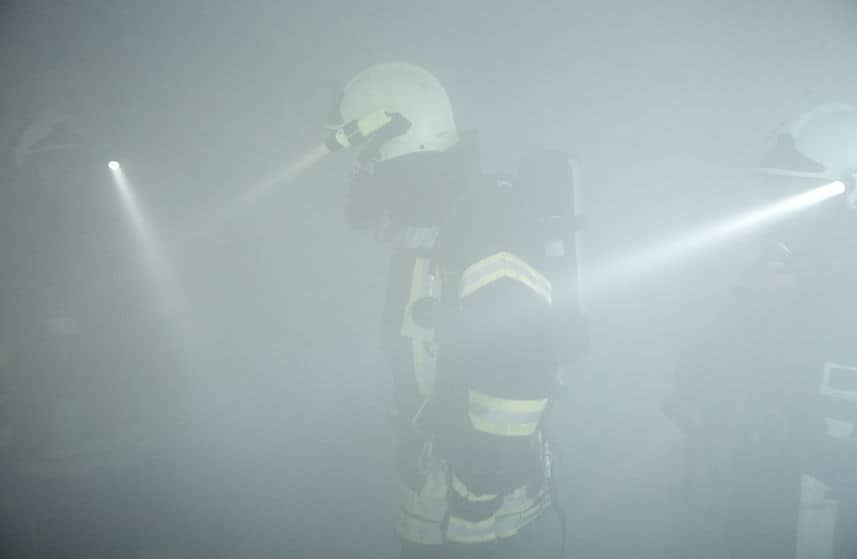 search rescue fire explosion, view of fire safety person in smoke