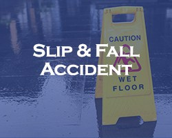 Slip And Fall Accident - blue overlay on a caution wet floor sign with a wet floor