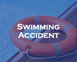swimming accident - blue over a PFD, flotation device, on the edge of a swimming pool