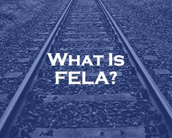 What Is FELA? - blue overlay on railroad tracks