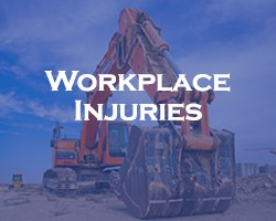 Workplace Injuries - blue overlay on construction equipment