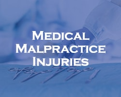 medical malpractice injuries - blue overlay on a close up of surgical tools during a surgery