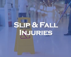 Slip & Fall Injuries -- blue overlay on a wet floor sign and people cleaning the floor behind it
