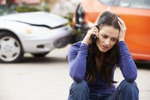 Female Driver Making Phone Call After Traffic Accident and rearending